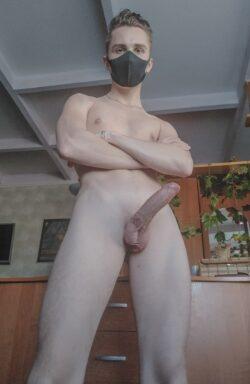 Masked boy with erection